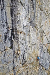 There are many summer crags near the town of Mammoth Lakes, just an hour north of Bishop. The well-featured Dike Wall, for example, has great granite sport and gear routes from 5.10 and harder. Grim Reality (5.10b) is a good option despite the dire appellation, as Jason Henrie discovers in this sea of granite. Photo: Ken Etzel.