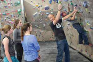 Dave Meyer, a Colorado Rocky Mountain School (CRMS) coach, works with team climbers on dialing in technique. In the longterm model, focus should be on gaining technique, then endurance, and last strength.