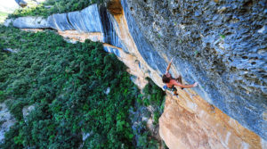 Chris Sharma fights the power on Policamente Corruptos (5.14d) at Margalef. Photo Keith Ladzinski.
