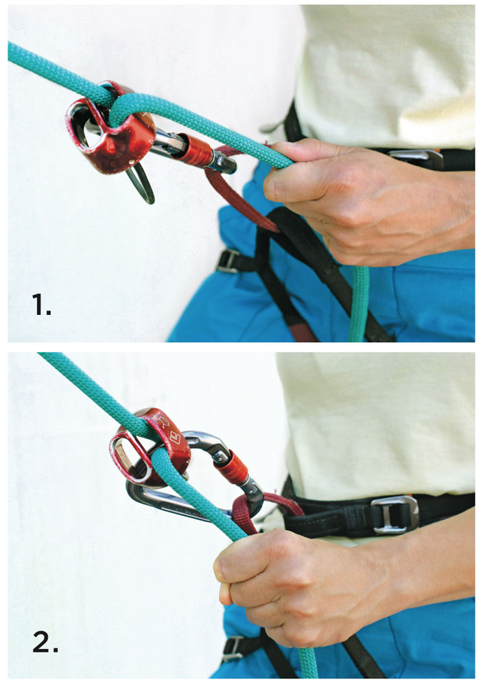 In the top photo the brake hand is held so it bends the rope across the side of the ATC, creating kinks. To lower someone kink-free, orient the rope so it runs straight into the device, as shown in the bottom image.