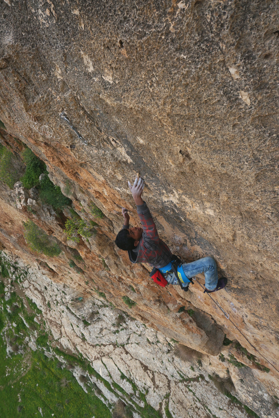 Twfyq, a Palestinian climber, on an Israeli route at Ein Fara. Photo: Miranda Oakley.