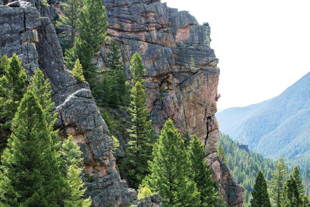 Aki Joy on Run Like Hell (5.10c), Gallatin Canyon, Montana. Photo: Seth Langbauer.