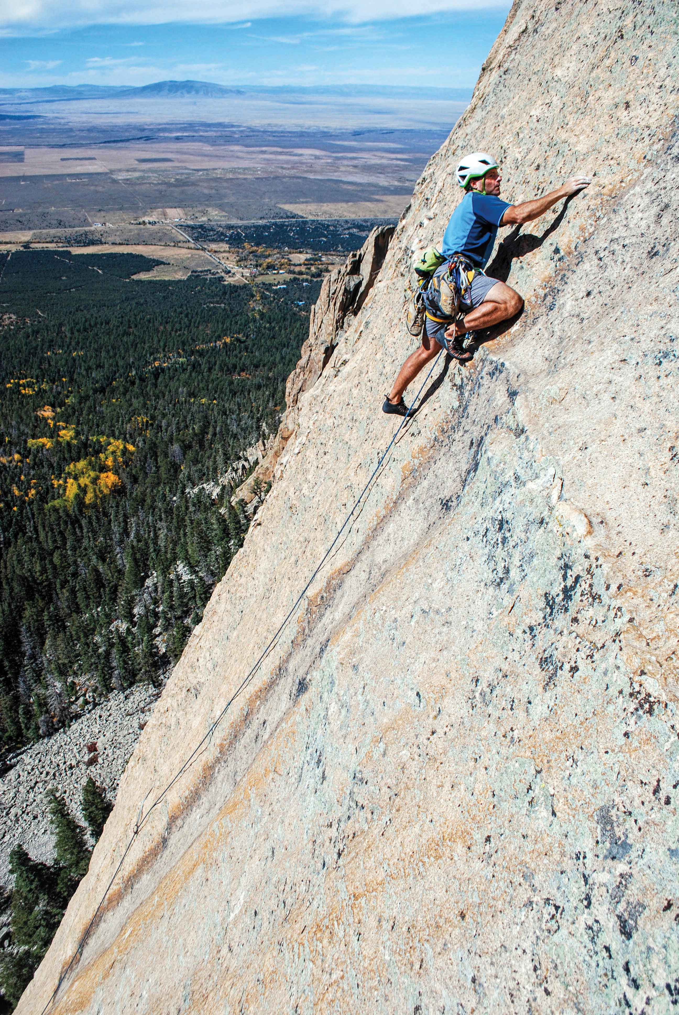 Dan Greenwald walks proud on the 5.10R fourth pith of Question of Balance (5.11) on the quality stone of Questa Dome, near Taos, New Mexico. Photo: Stewart Green.