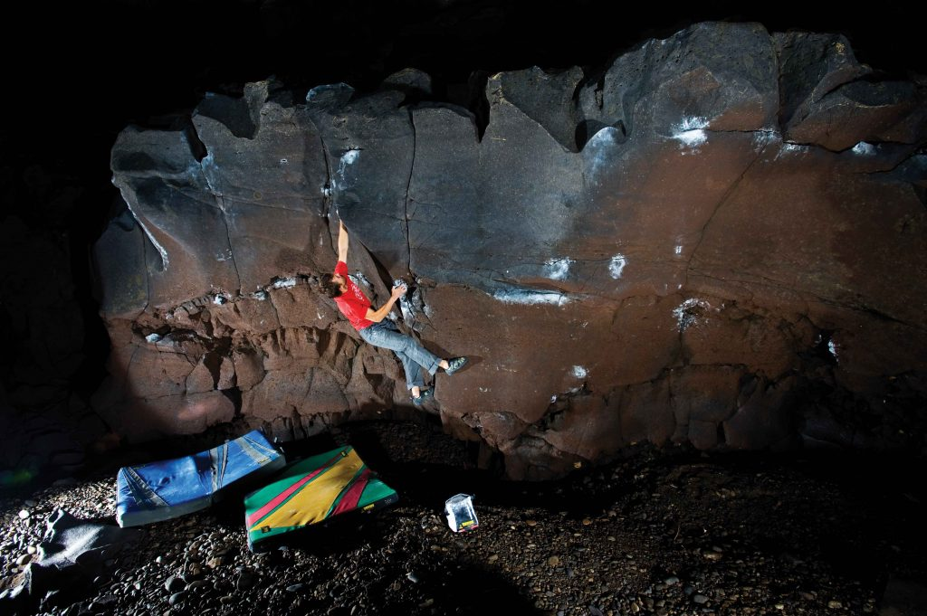 Mike McClure on Tomahawk Left (V6), the Channel Tubes, Idaho. Photo: Nathan Smith.