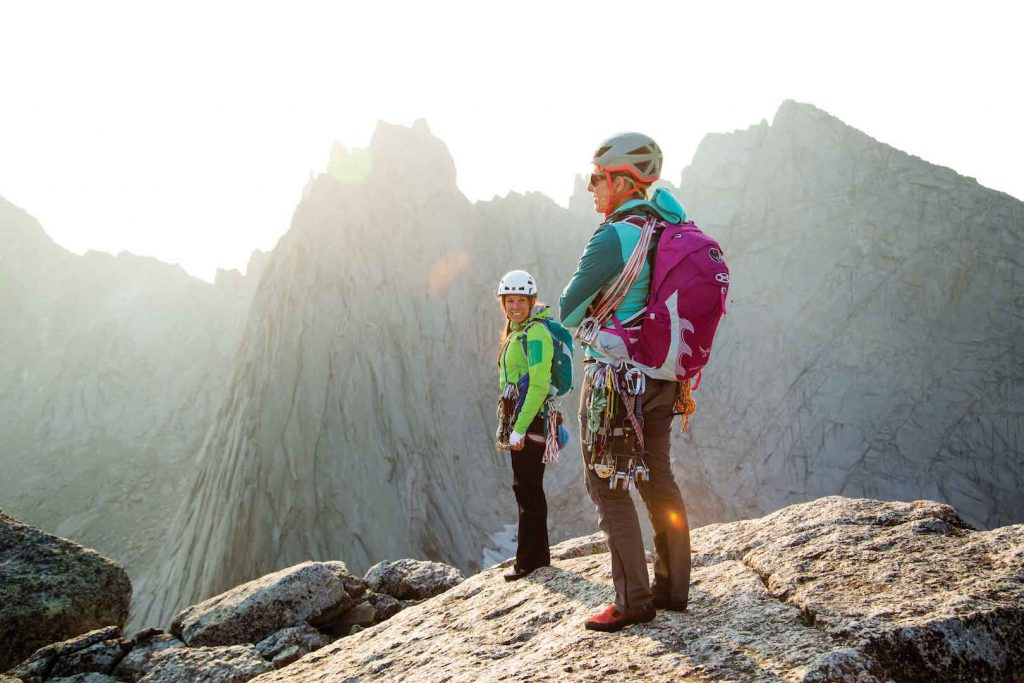 Kim Havell and Julia Heemstra take in the view from the summit of Pingora, Cirque of the Towers, in Wyoming's Wind River Range. Photo: Dan Holz.