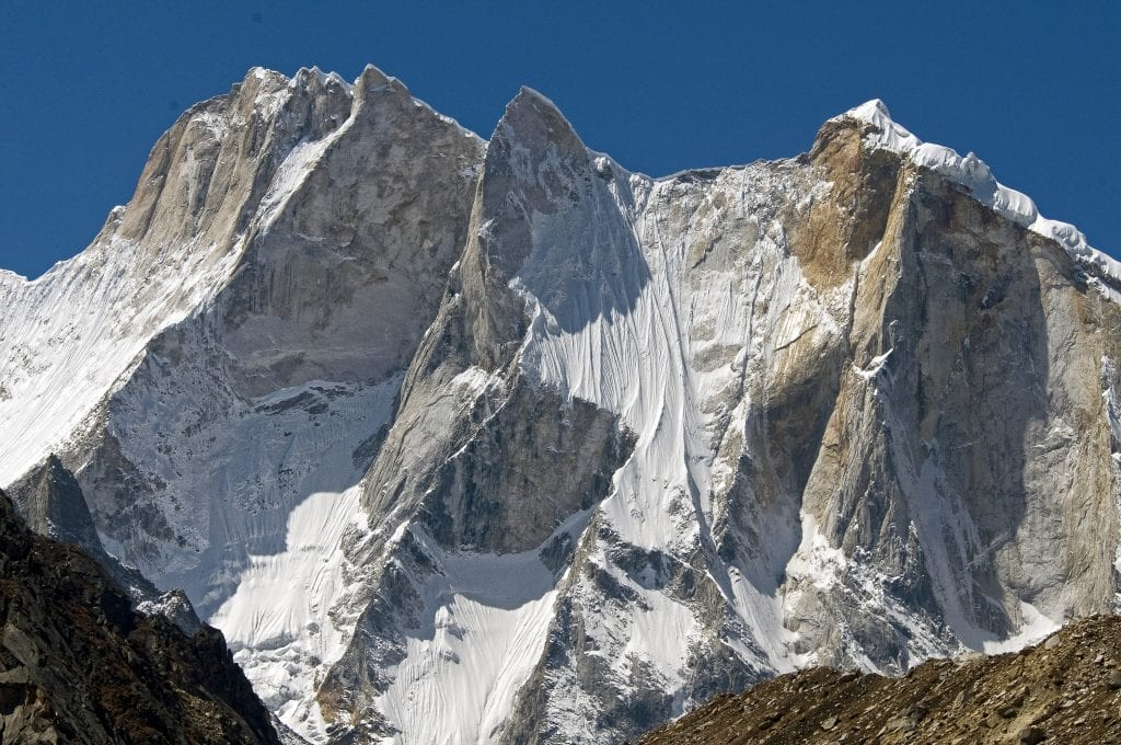 The Shark's Fin (center) of Mount Meru (6,310 meters) has denied over 20 different expeditions of some of the world's strongest climbers. In fall of 2011, Conrad Anker, Jimmy Chin and Renan Ozturk completed the line up the striking knife-blade arete. Photo: Jimmy Chin