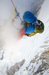 After nearly three weeks of deprivation on Meru, Renan Ozturk reaches his breaking point in 2008 here, at the Stegosaur belay, as spindrift pummels him. Photo: Jimmy Chin