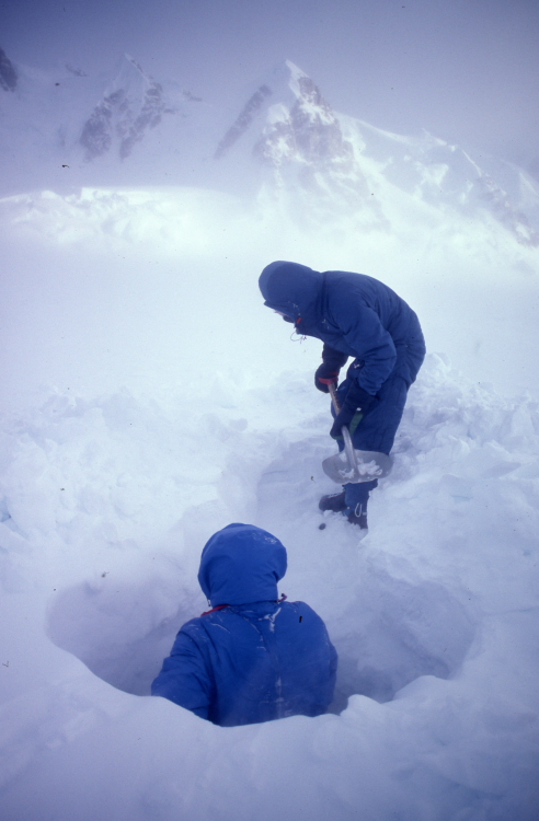building a snow shelter on Denali in winter