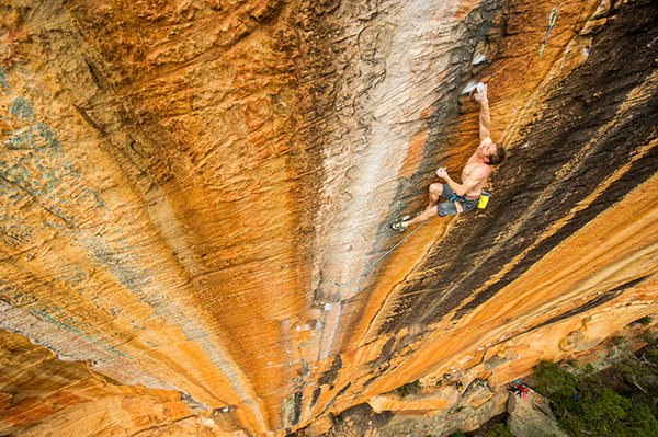 Lee Cossey attempting his 55m project, which he climbed on his next attempt, and called Sneaky Snake (33) on Taipan Wall, Grampians, Victoria, Australia. Photo: Simon Carter.