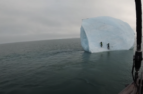 Weekend Whipper: Iceberg Rolls With Ice Climbers On It!