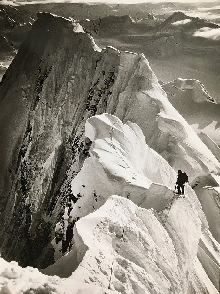The essence of ridge climbing, on terrain like what the author encountered on Mount McGinnis. Matt Van Enkevort is shown high on D2, a 10,200-foot peak on the crest of the Hayes Range divide, Alaska. Photo by Roman Dial.