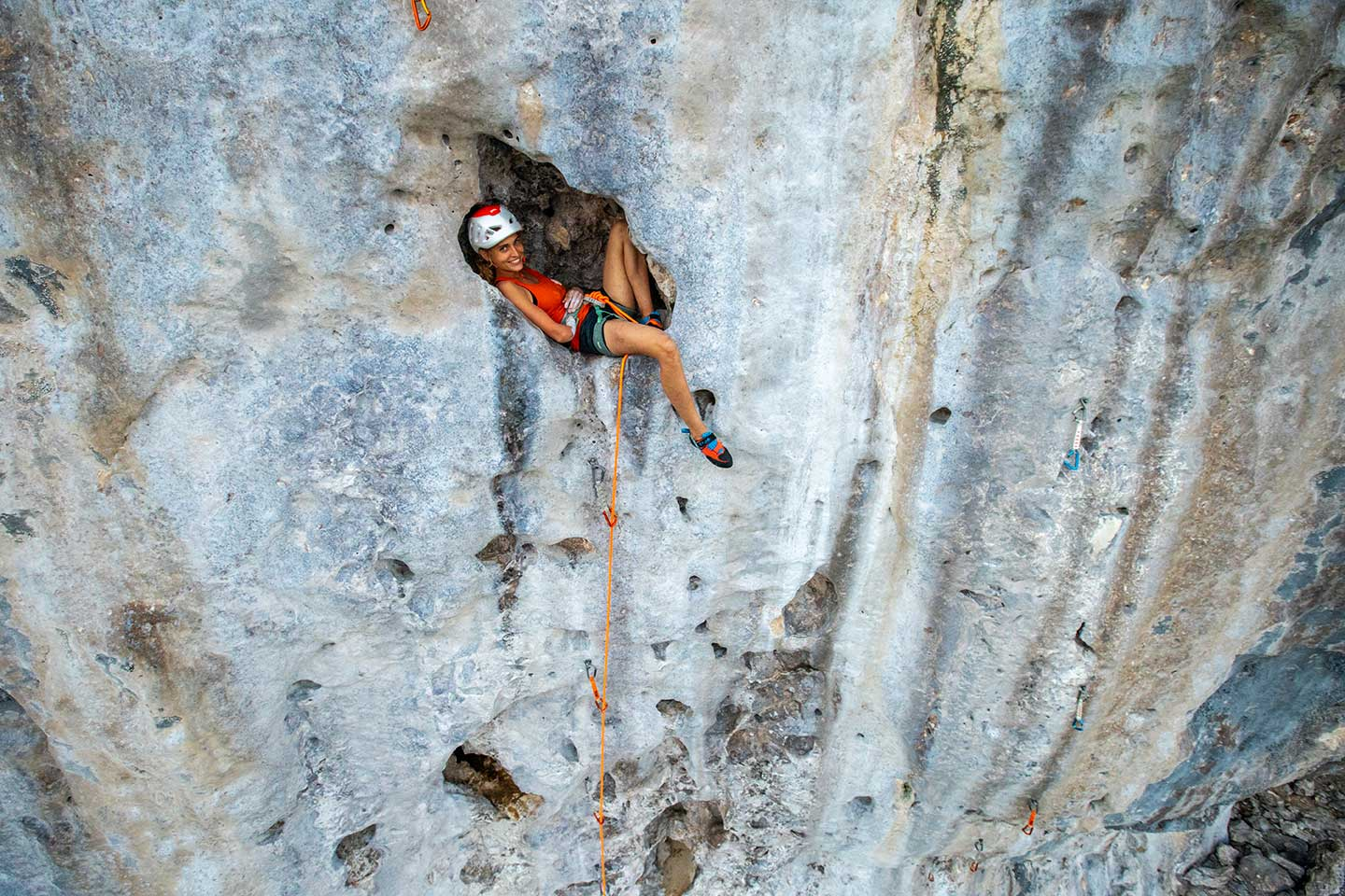 Following spread The Paraclimbing World Champion Solenne Piret, takes a rest on <em>Esprit Traditionnel</em> (6b+ / 5.10d). Photo: Courtesy of Gestalten.