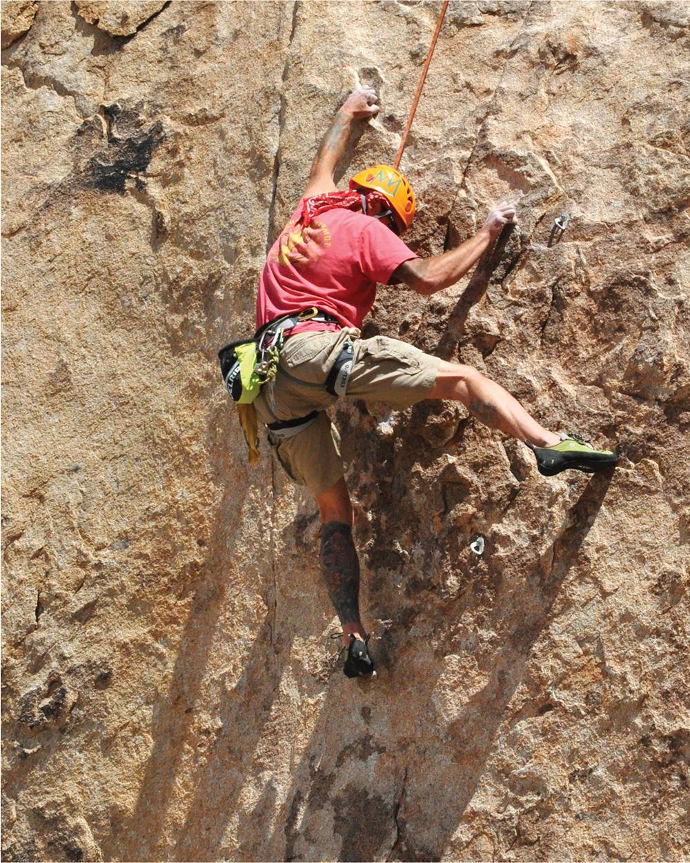 Gavin Bridgeman topropes Sig Alert (5.10b), Joshua Tree National Park, California.