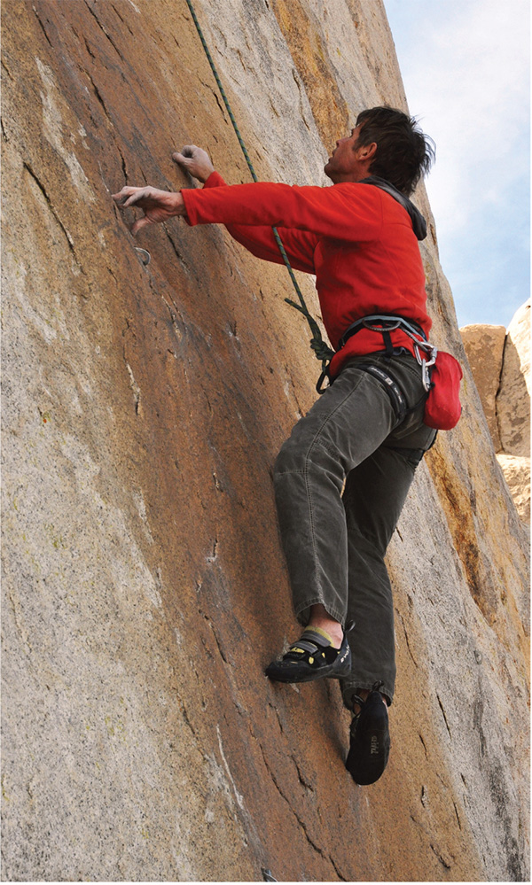slab climbing. Peter Croft using proper edging technique on a steep slab—weight out and over the feet, heels slightly higher than the toes, heels in to the rock.