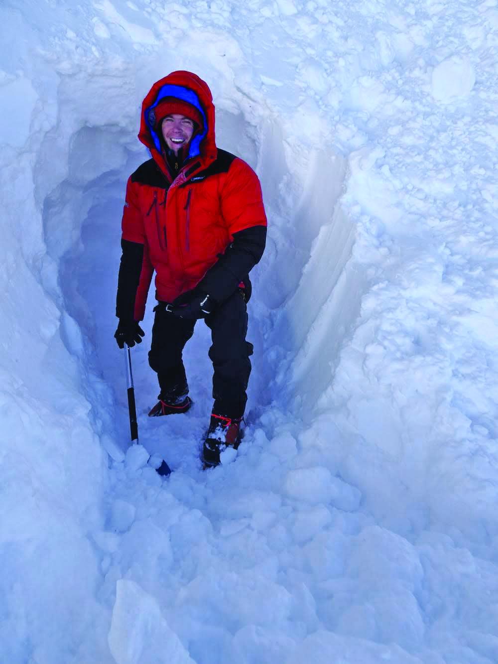 Tom Ballard shovels out a snow cave on Nanga Parbat. Photo: Daniele Nardi.