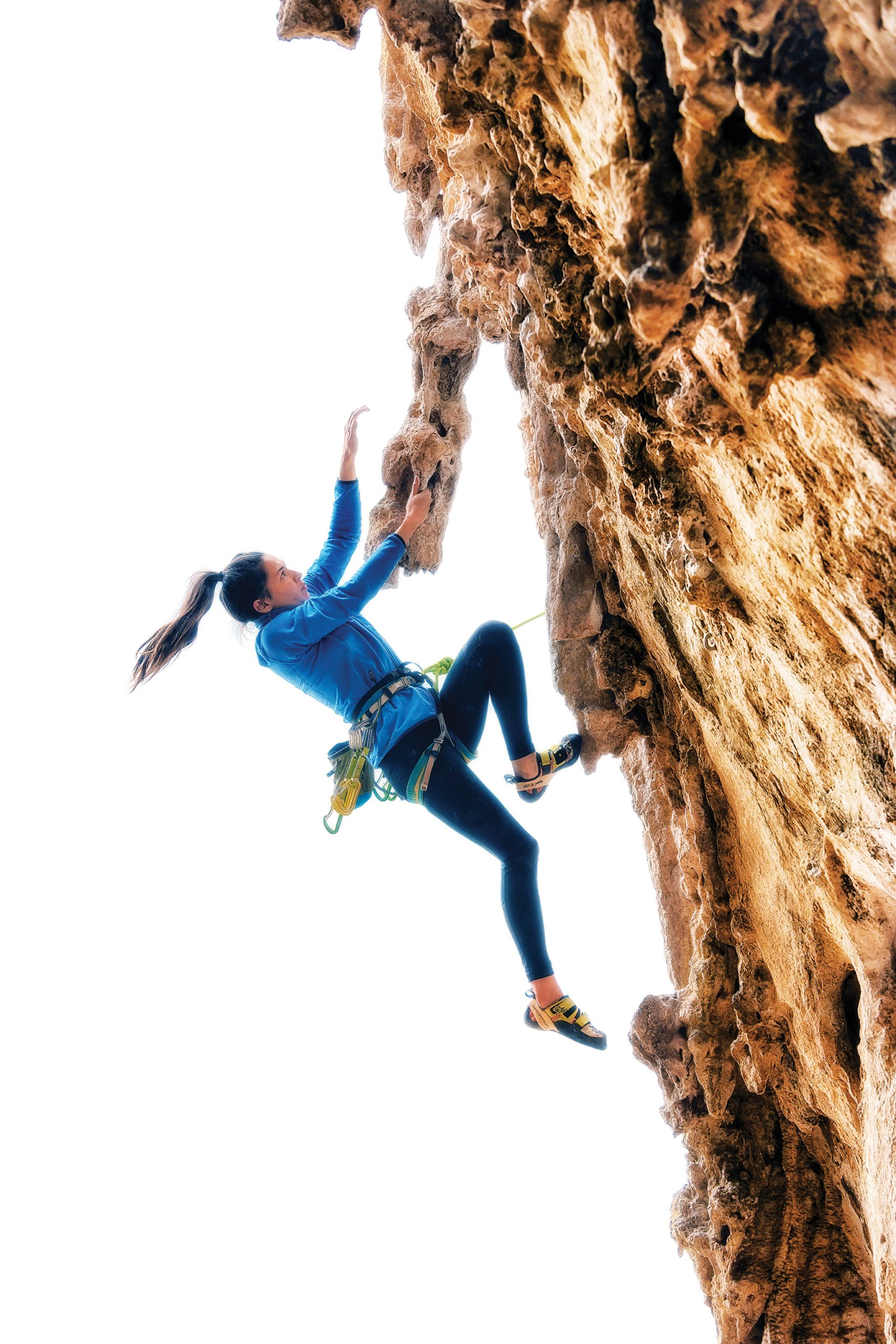 Palms warms up on <em>Baldassarre</em> (5.11a), a moderate in the Grotta del Cavallo. Photo: Jeff Rueppel.