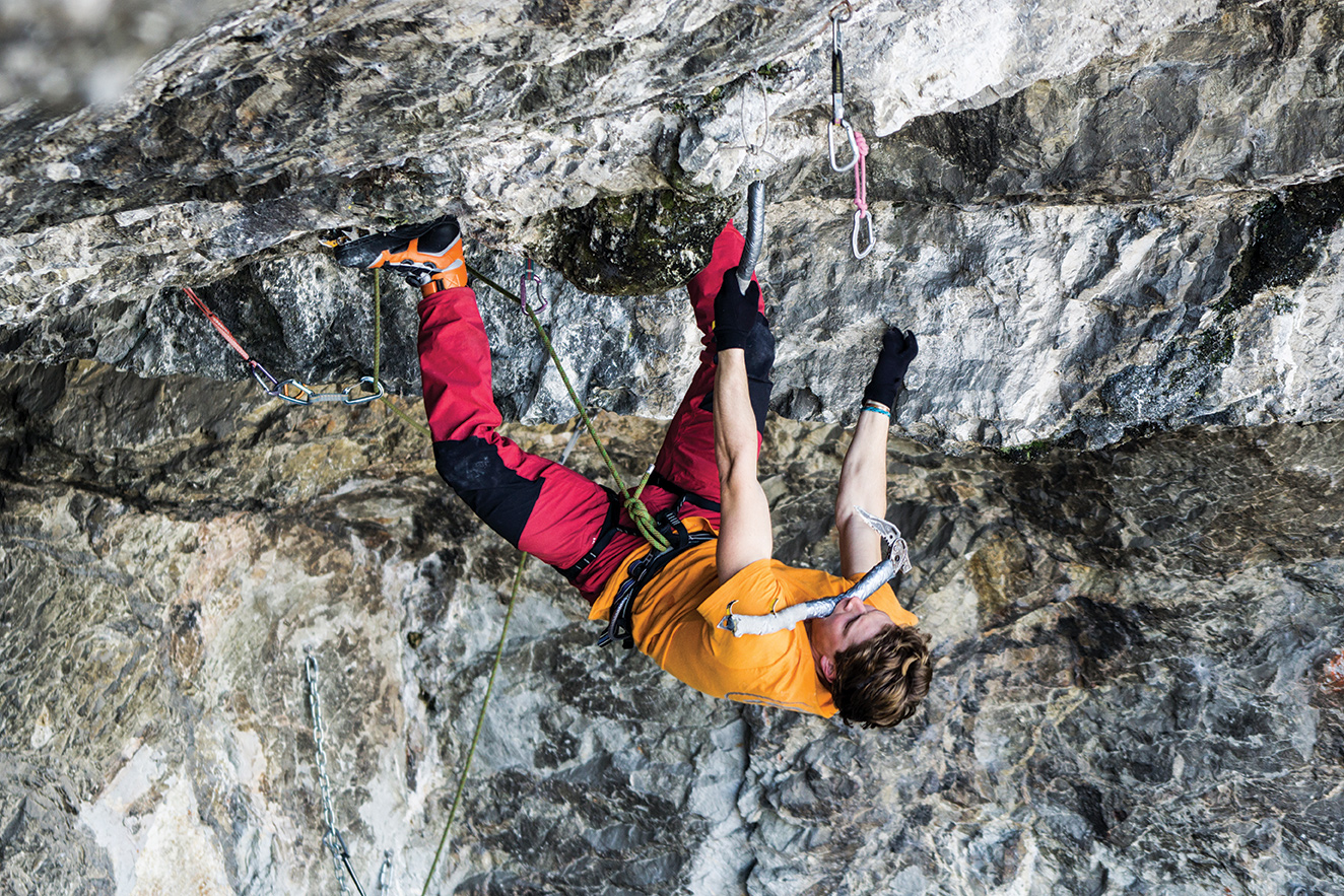 Tom Ballard on Low G Man, a D14 at Bus del Quai, Italy. He sent the route on his second try, without using figure 4s, and with his mother's old ice tools. Photo: Ruggero Arena.