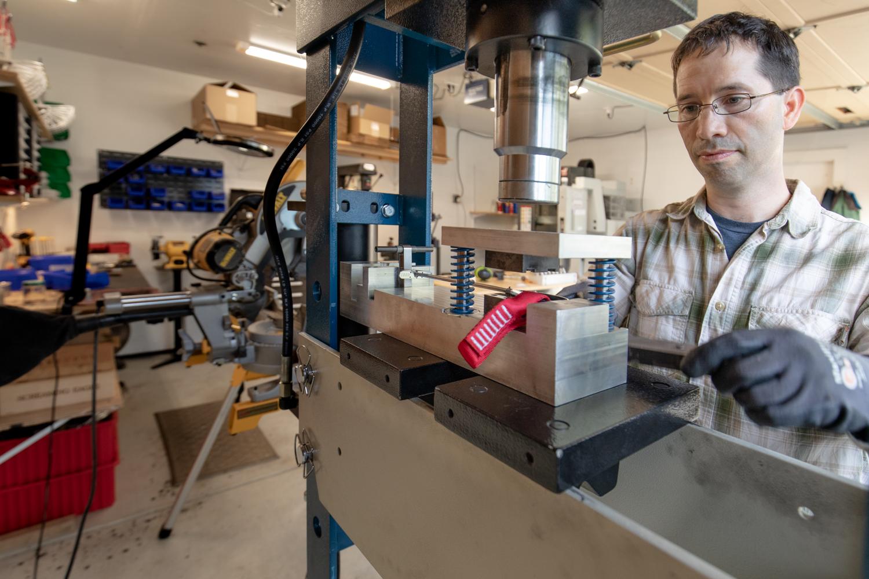 Davidson hard at work in his garage workshop of Merlin Rock Gear. Photo: Ellen Baker.