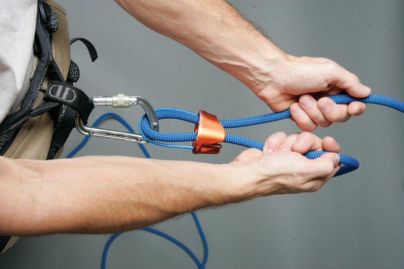 Wrong! For a standard plate-style belay device to lock, the brake side of the rope must be held at an angle. However, holding the ropes parallel (above) is a commonly taught technique despite the fact that this position cannot hold a fall!