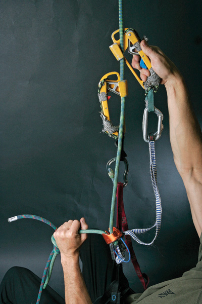 <strong>2.</strong> Double Up. Attach your second ascender on the rope above your first (and now fully weighted) ascender. Keep the slings connecting each ascender to your harness short, so you can easily reach them. A 12-inch sling (or daisy) works well for the bottom ascender; clip a 24-inch sling to the top ascender. If the top sling is too long, the ascender can shoot out of reach—another hassle.