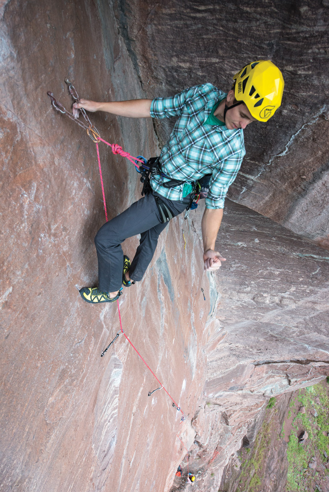 A climber communicates with his belayer.