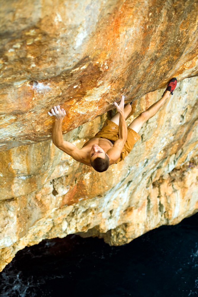 Ethan Pringle guns for a two-finger pocket on a long-standing project at Cala sa Nau. Pringle stuck the move, but fell before reaching the top.