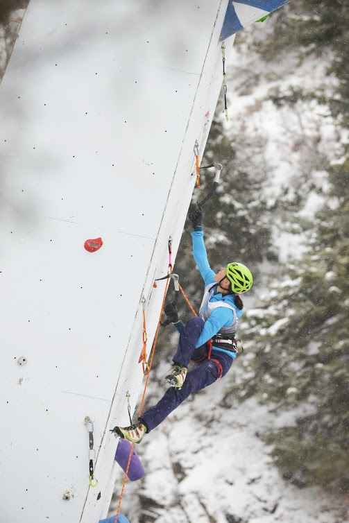 Winner of the female mixed and speed events Ines Paper throws down a figure-four near the top of the dry tooling wall. Photo: Francis Sanzaro.