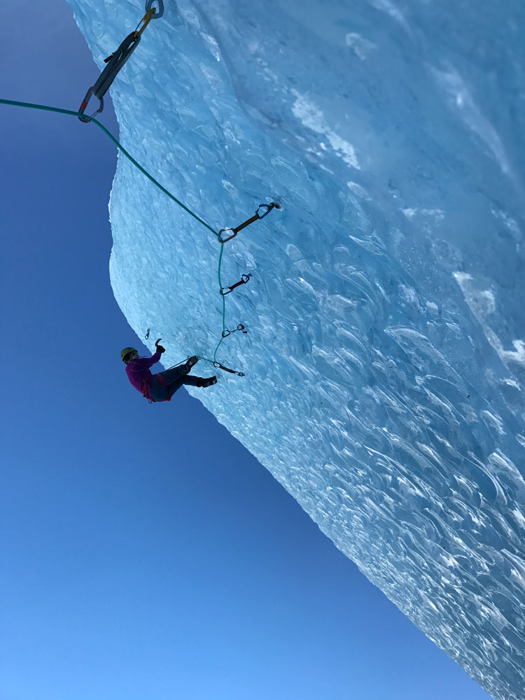 """Rebecca Lewis, in photo, and Nathan Kutcher spend a """"rest day"""" away from their mixed projects climbing an overhanging iceberg on Glacier Lake."""