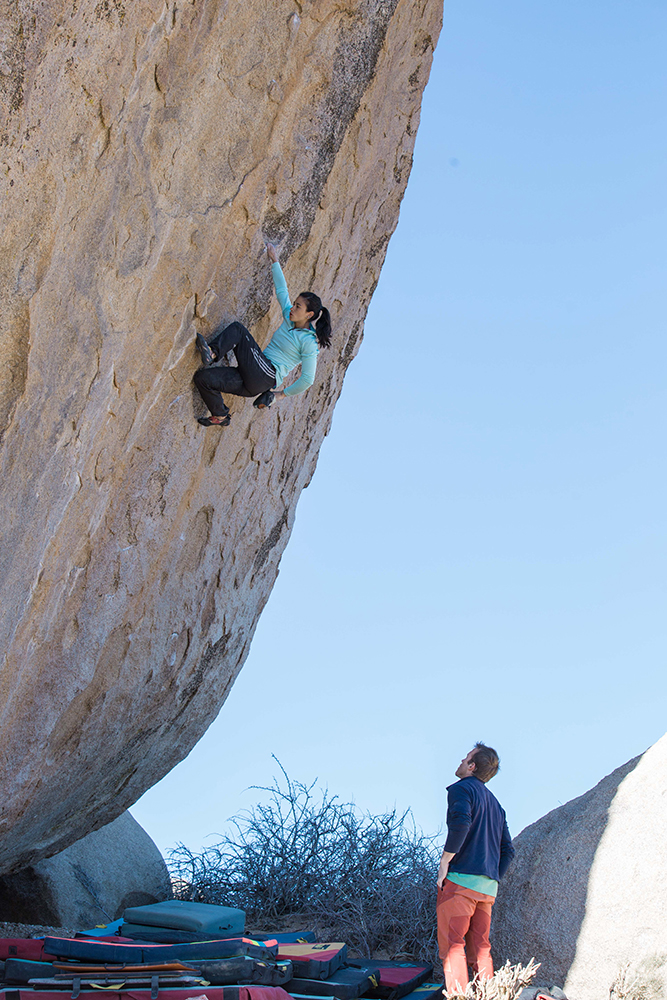 Nina chalking up, only one-third of the way up <em>Ambrosia</em>. Photo: Colette McInerney.