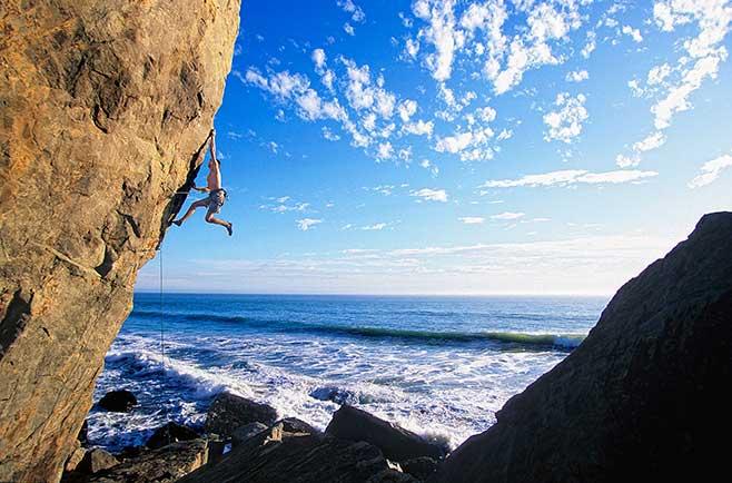 What the dearly departed <em>Beach Crack</em> left behind: <em>Mickey&#39;s Beach Arete</em> (5.13c), here enjoyed by Chris Sharma. Photo: Jim Thornburg.