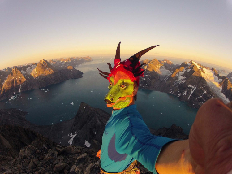 Mike Libecki on a summit in Greenland wearing a Year of the Dragon mask. Photo: Mike Libecki / REEL ROCK.