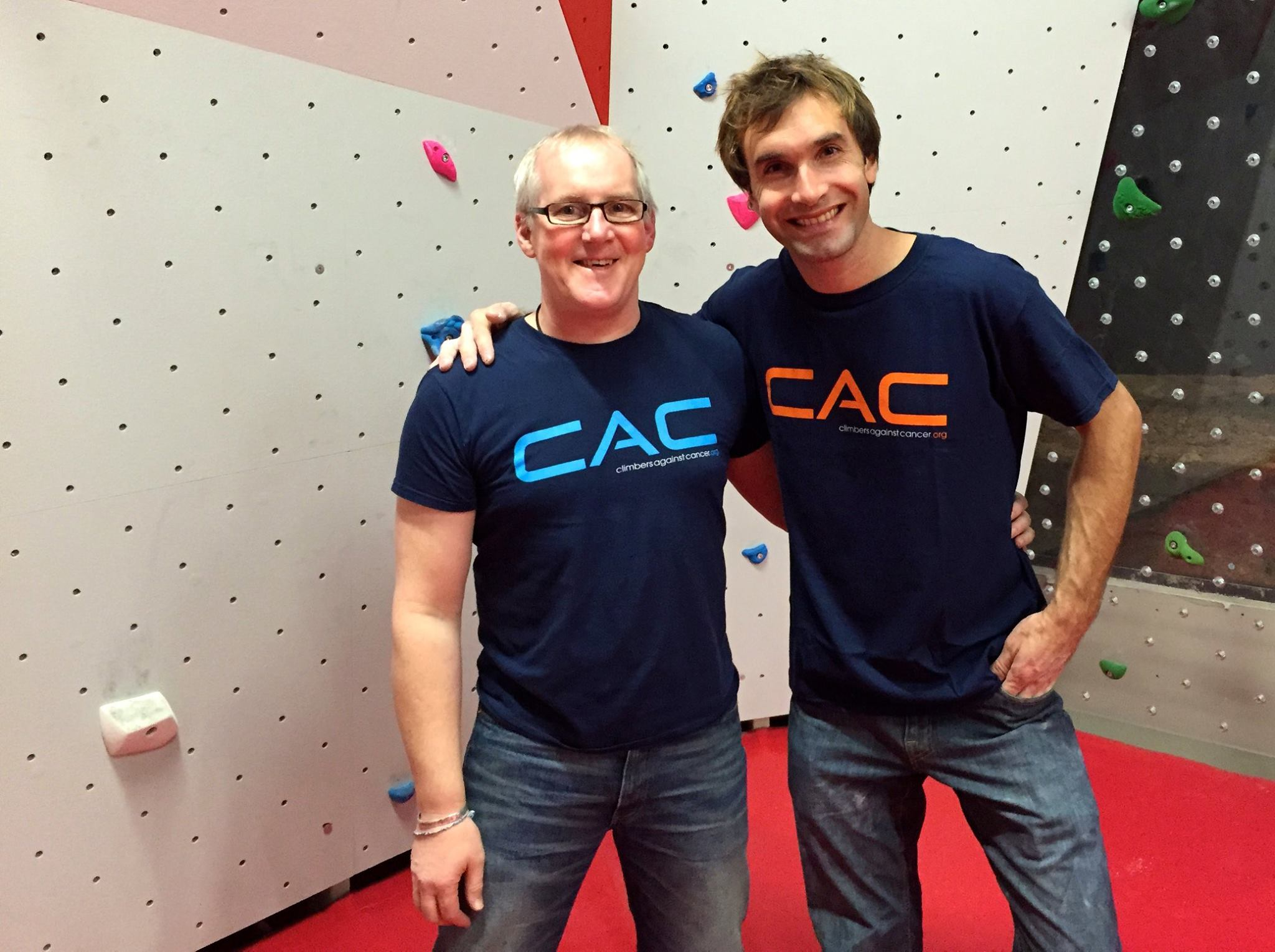 John Ellison (left) with Chris Sharma sporting CAC T-shirts. [Facebook photo]