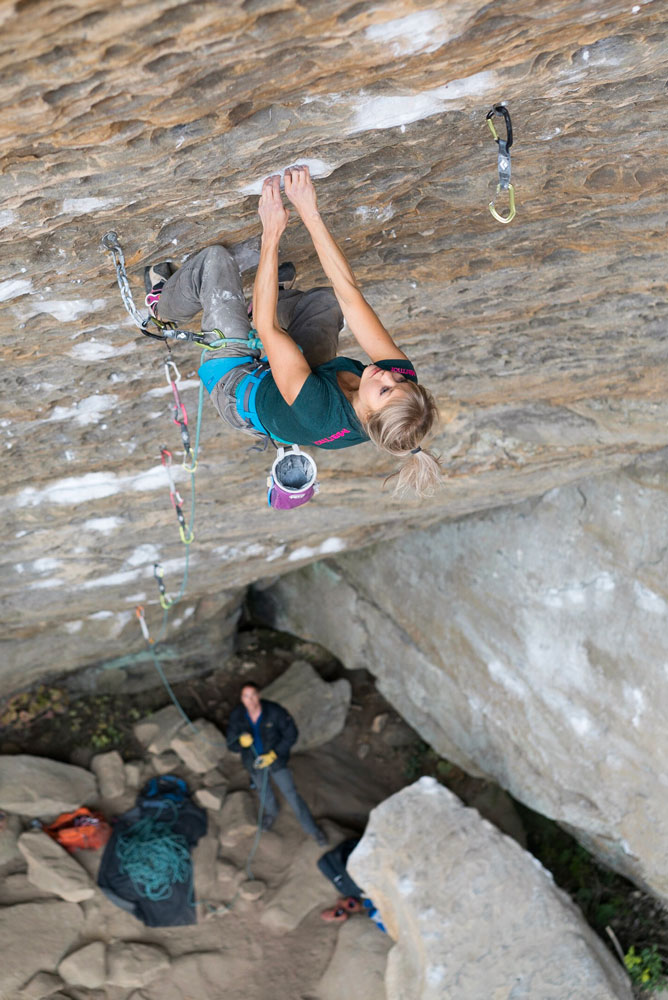 "Anna Liina Laitinen on <em>Southern Smoke</em> (5.14c),     Bob Marley Crag, Red River Gorge, Kentucky. Photo: Matty Hong."" title=""Anna Liina Laitinen on <em>Southern Smoke</em> (5.14c), Bob Marley Crag, Red     River Gorge, Kentucky. Photo: Matty Hong."" style=""float: right; margin: 0px 0px 10px 10px;""><em>Southern Smoke </em>(5.14c),     at the Bob Marley Crag of the Pendergrass-Murray Recreational Preserve (PMRP), was equipped by Joe Kinder and Brad Weaver in 2008. Kinder called it     ""one of the cleanest routes that I have ever bolted (half bolted anyway)."" They worked out the beta together, and soon after, made back-to-back ascents.</p> <p>The ninety-foot route consists of sustained, steep climbing. ""I think the crux for me was memorizing all that beta,"" Laitinen says. ""There was just too     many options and chalk so I used different beta every time, and I had to change beta on the fly. There were also some really long moves, which demanded     some faith from me. And slopey holds are definitely my weakness, that's for sure!""</p> <p>She adds that the route didn't suit her style ""at all,"" but that only made the projecting process a more rewarding experience. ""The whole process was a     mix of love and hate and rebellion,"" she says. ""That 'slap' just made me [want] to try even harder … I went happily to it even though I was     so tired that I couldn't even link any moves and my skin was screaming and bleeding. But I tried again.""</p> <p>When asked how many attempts it took her, she said, ""I took plenty!""</p> <p>Known for her endless psych, Laitinen says this time it almost cost her the whole trip, which was her first to the Red River Gorge. ""After our first day     I was so stoked that I couldn't even sleep. I woke up at 5 a.m. and started to get ready!"" she says. ""That psyched backfired later when it led to skin     issues. Still, I wouldn't change anything.""</p> <p>Her main project, <em>Pure Imagination, </em>gave her ""heinous splits for weeks,"" she says, and when she realized that her fingertips would not     heal fast enough for <em>Pure Imagination, </em>she shifted her sights to <em>Southern Smoke, </em>a route she had attempted a few times while     climbing in the area with Matty Hong earlier in the trip. But she didn't try <em>Southern Smoke </em>""seriously"" until her last week of the trip.</p> <p>""When I finally clipped the chains, I couldn't believe it,"" she says.</p> <p>""This was my first time [to the RRG] and definitely not the last! We still have some amazing sectors left we didn't even see!!! Can't wait to go back there!!!""</p> <p> </p> <p><strong>In other news from the Red,</strong> Matty Hong finished a Jonathan Siegrist project, which Siegrist bolted in 2011. ""It climbs a slightly overhanging     face and has a difficult boulder at the end. Maybe V10?"" Hong tells <em>Rock and Ice</em>. He kept Siegrist's name, <em>Apple Juice Flood</em>, and     suggested 5.14c for difficulty.</p> <p>Hong also made the first ascent of another open project, bolted by Andrew Gearing, at the Chocolate Factory, called <em>Sweet Tooth</em> (5.14b). ""It climbs     out a steep cave and consists of hard bouldering for four bolts,"" he says.</p> <p> </p> <p><strong><span style="