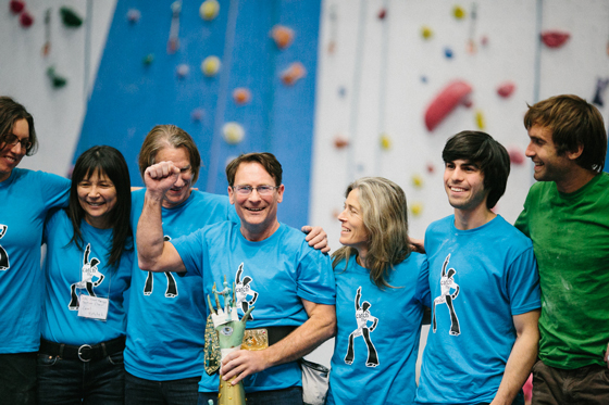 Happy winners: Madaleine Sorkin, Carol Kotchek, Jamie Logan, Phil Powers, Lynn Hill, Jon Cardwell and Chris Sharma rocking his own team shirt. Photo by Kirsten Ellis.