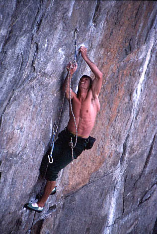 Mike Carville cranking down on <em>A Steep Climb Named Desire</em> (5.13d). Photo by <a target=