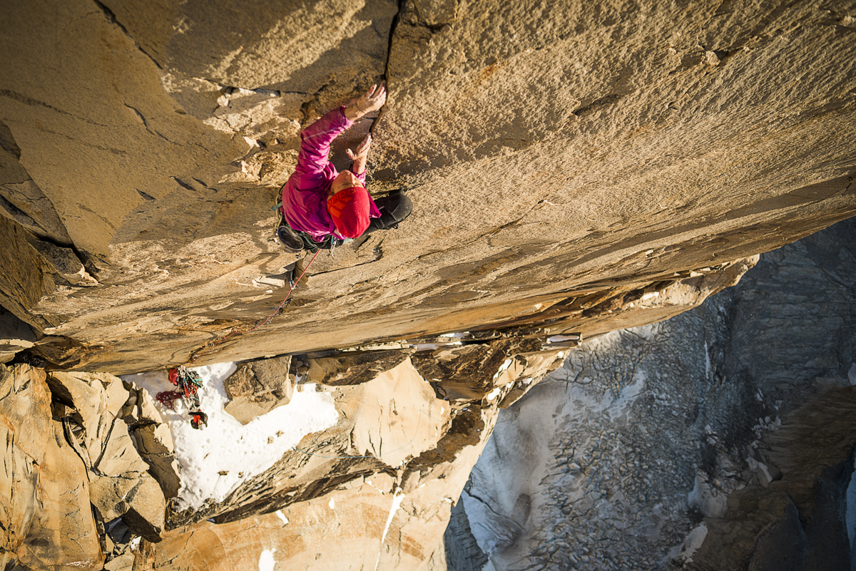 """Mayan Smith-Gobat, from New Zealand, climbing pitch 31 (7c+/5.13a ) on <em>Riders on the Storm</em>. Photo: Thomas Senf.&#8221; title=&#8221;Mayan Smith-Gobat, from New Zealand, climbing pitch 31 (7c+/5.13a ) on <em>Riders on the Storm</em>. Photo: Thomas Senf.&#8221; style=&#8221;float: right; margin: 0px 0px 10px 10px;&#8221;>A     week later, Smith-Gobat, with bleeding fingers, freed pitch 29 and pitch 31, before the upper crack """"became a waterfall from ice melting above,"""" she     says. Nevertheless, the team pushed on and reached easier fifth-class terrain that led to the summit. At 12:48 p.m. on February 6, they stood on top.</p> <p>""""After living on the wall, only ever seeing one side of the landscape for weeks, it was incredible to reach the summit,"""" says Smith-Gobat says. Their rare     ascent was awarded with a rare cloudless and windless Patagonian day and 360-degree views of Torres del Paine National Park. """"Endless peaks, stunning     untouched walls, glaciers and lakes stretched out as far as the eye could see.&#8221;</p> <p>That night, rock fall pummeled their portaledges. </p> <p>A wave of warmer weather had thawed the ice that locked together the loose blocks above that comprised the tower's peak above.</p> <p>Rocks tore through the center of Papert and Smith-Gobat's shared portaledge, narrowly missing them. They were unnerved by the event, but still determined     to finish what they came for. The team continued to work the lower pitches.</p> <p><img src="""