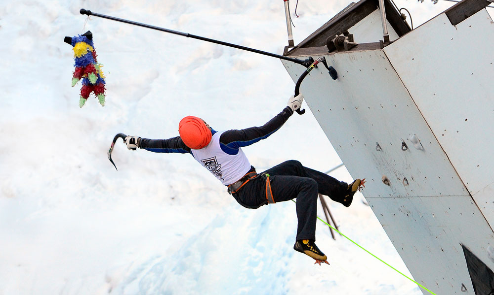 Jeff Mercier makes the runout exit dyno to hit the pinata to win at the 2014 Ouray Ice Festival mixed competition.
