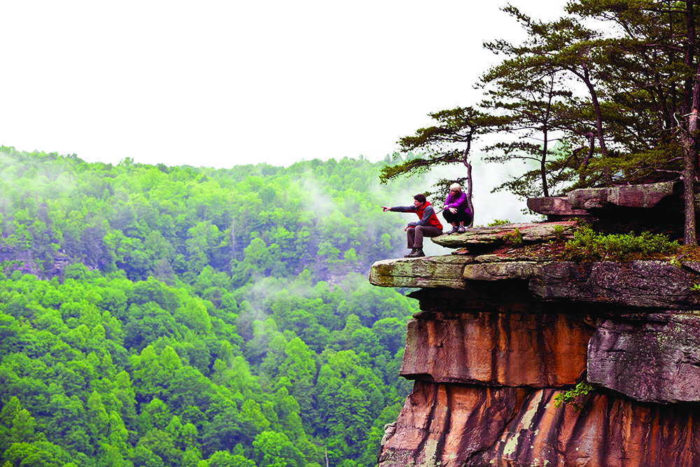 Bayard Russell and Regan Kennedy check out the wealth of climbing at the New River Gorge, West Virginia.  Photo by Anne Skidmore.