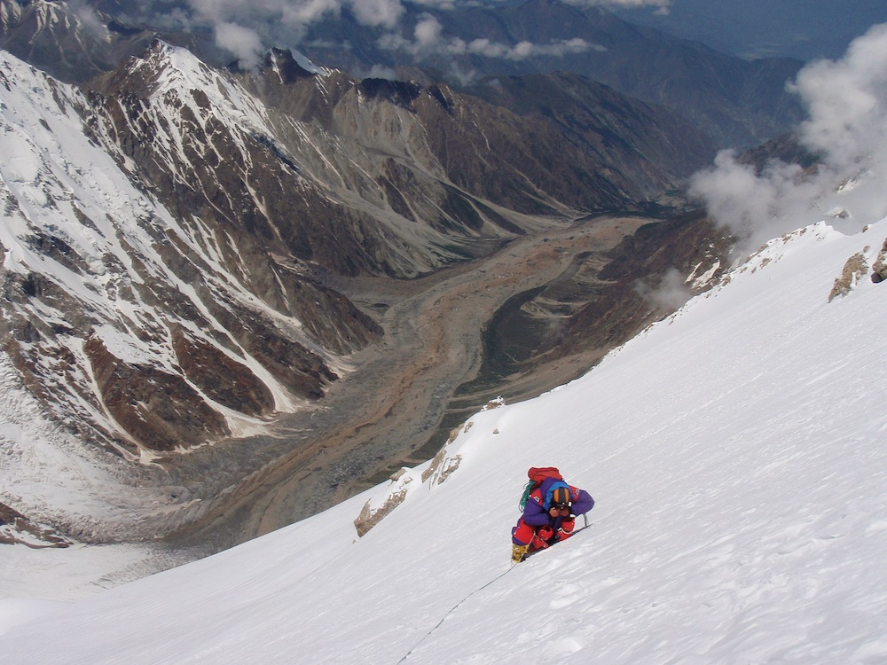 Rick Allen, during the descent of the Kinshofer route and feeling the effects of almost two weeks' climbing. The Diamir glacier in the distance. Photo: Sandy Allan.