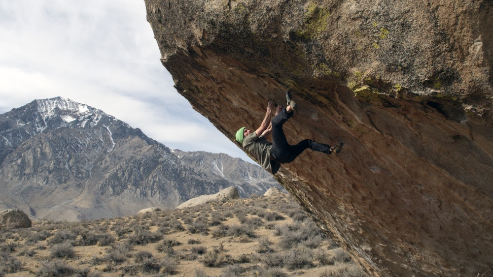 Daniel Woods on the highball boulder problem The Process, Bishop, California. Photo: Max Krimmer.