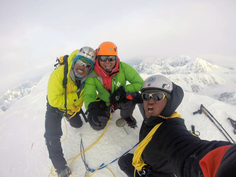 Nima Tenji Sherpa, Tashi Sherpa and Tenzeeng Sherpa celebrate with a summit-selfie at the top of North America, following their successful ascent of the West Rib. Photo courtesy of Tashi Sherpa.