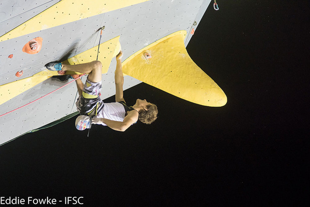 Domen Skofic chalking up in Briancon, France. Photo: Eddie Fowke / IFSC.