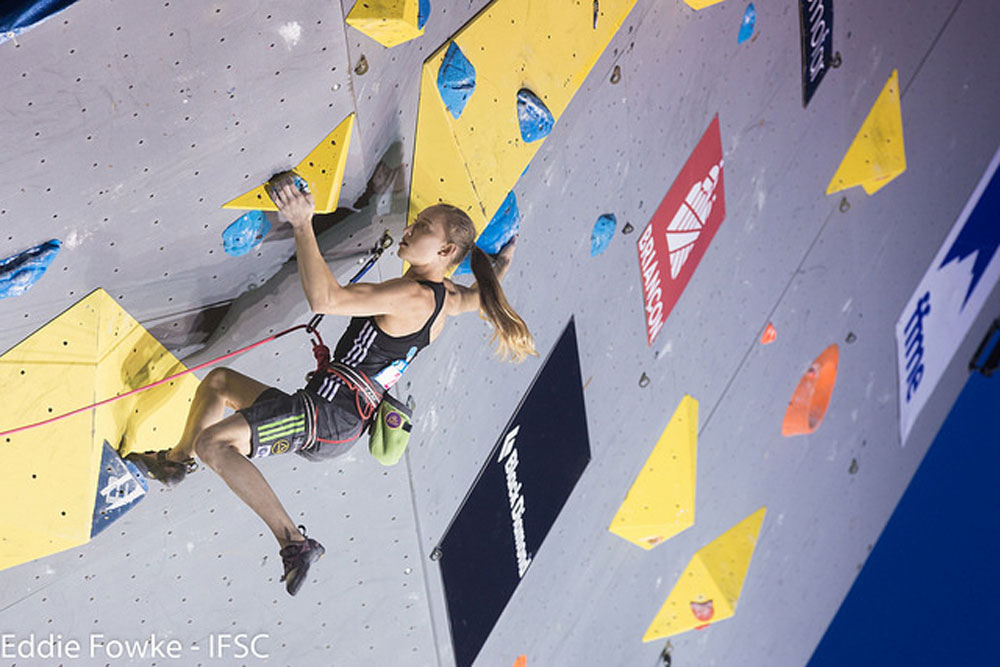 Janja Garnbret making moves on the Finals route. Photo: Eddie Fowke / IFSC.