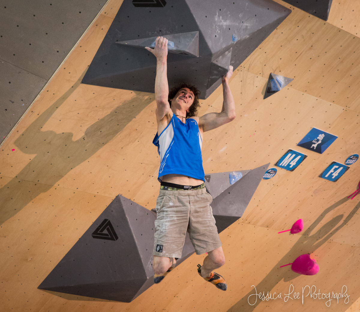 Adam Ondra climbs the final boulder problem to place third. Photo by Jessica Lee.
