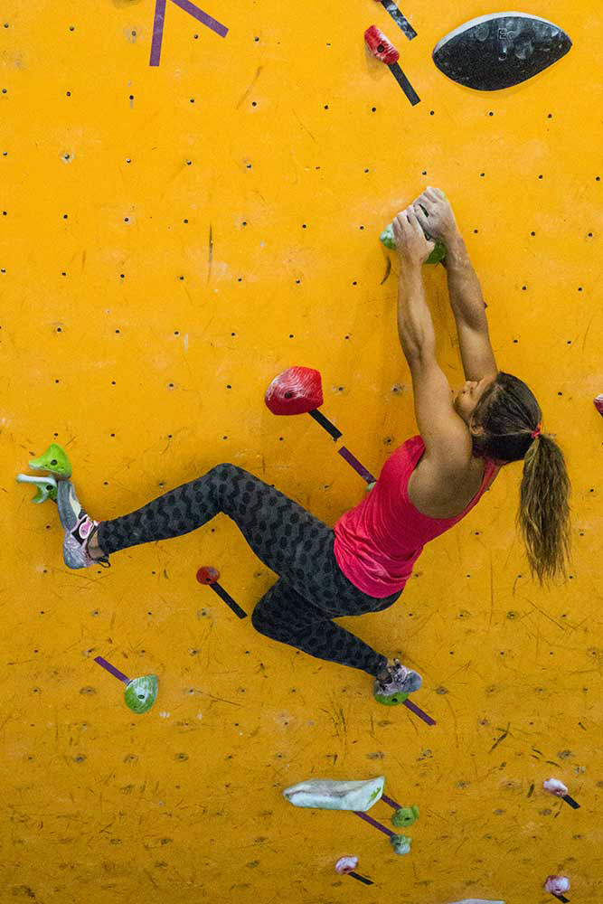 Meagan Martin locks in and stabilizes with a drop knee. It improves the feel and utility of the holds. Photo by Angie Payne.