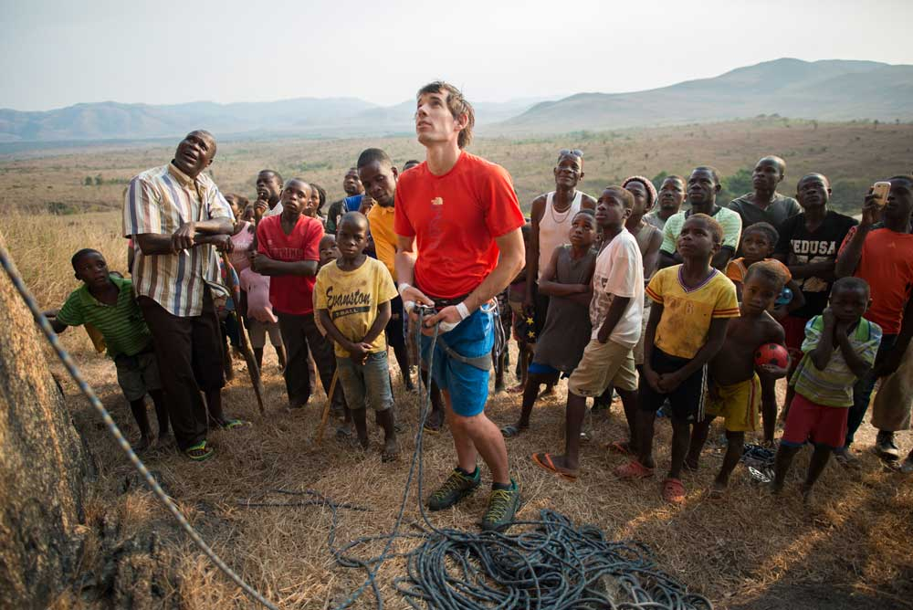 Alex Honnold belays in front of a curious crowd, Angola, Africa