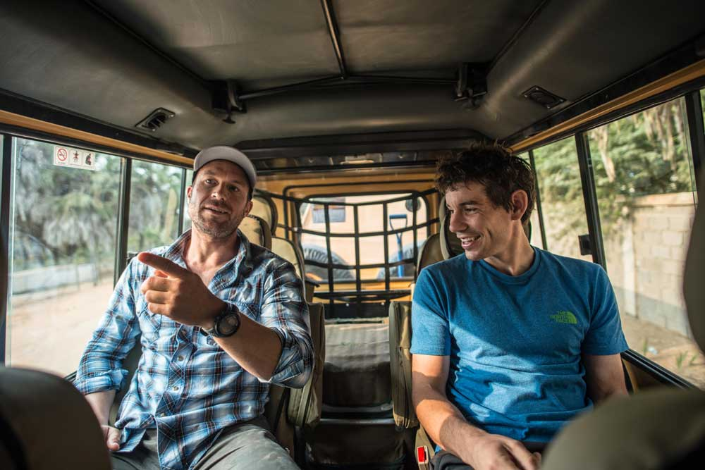 Honnold and Maury Birdwell, Honnold Foundation Executive Director, taking in the Angolan countryside from the back of their Land Cruiser.
