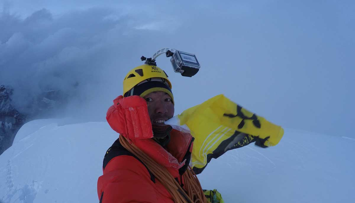Mingma Sherpa on the summit of Mt. Chobuje, Nepal before the storm blew in. Photo courtesy of Mingma Sherpa.