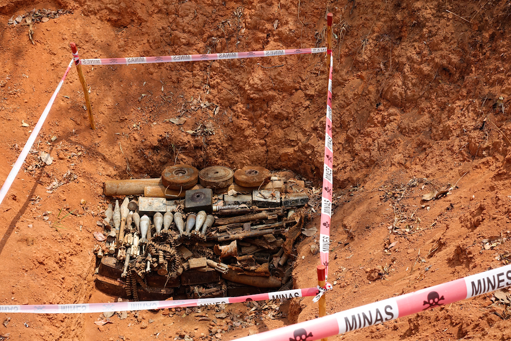 A pile of UXO (unexploded ordinance) uncovered and marked for disposal by The HALO Trust. Angola's 30 year civil war left the country littered with over 1500 active minefields. To date, over half those minefields have been cleared, largely due to efforts from NGOs like HALO