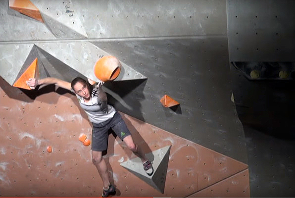 Janja Garnbret pirouettes to victory on the fourth boulder problem. Photo: Screenshot from live stream video.
